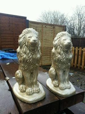 Pair of golden lions garden statues