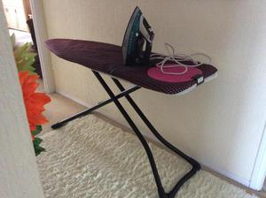 dry cleaners ironing board and steam iron posot class