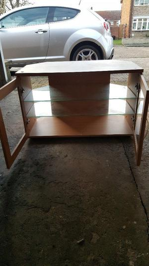 Tv stand with glass doors and shelves