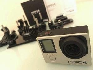 *STILL UNDER WARRANTY* GoPro Hero 4 Black + 64GB + accessories + 3 extra batteries
