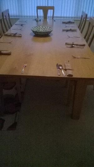SOLID OAK DINING TABLE AND EIGHT CHAIRS HANDCRAFTED IN PEMBROKESHIRE. [PRICE REDUCTION].