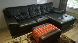 Black leather sofa (chaise lounge) and footstool