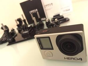 *STILL UNDER WARRANTY* GoPro Hero 4 Black + 64GB + accessories + 3 extra batteries *MUST HAVE*