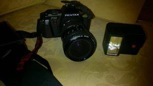 Pentax p30. Camera. And extras