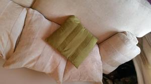 a 4 seater cream coloured scattr cushion back posot class