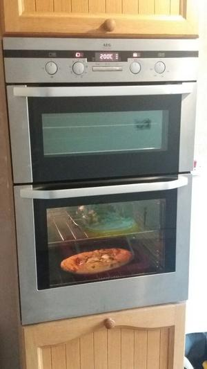 AEG Stainless Steel double oven integrated. With Neff gas hob and neff extractor