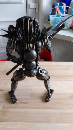 Predator metal figure with axe