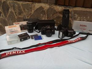 Pentax Super A Camera with three lenses and other accessories.