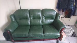 3 seater and 2 seater dark green leather style sofas.