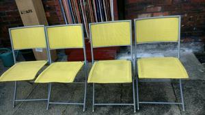 4 folding garden chairs.