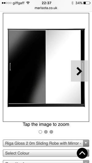 2 black mirrored wardrobes