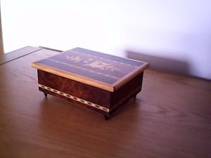 Inlaid wooden musical jewellery box