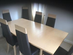 Excellent condition - dining room table with 8 chairs & matching cabinet.