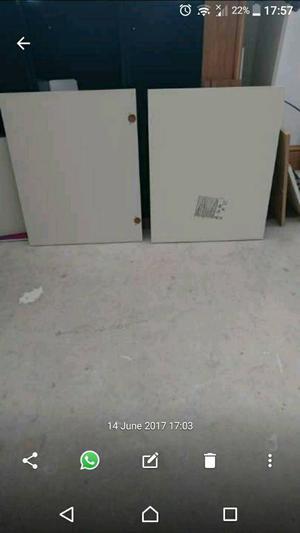 Pair of cream gloss kitchen cabinet doors.
