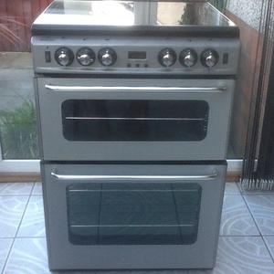 New World gas cooker - in silver.