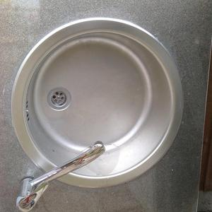 Stainless sink and mixer taps