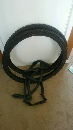 Pair of mountain bike tyres and inner tubes
