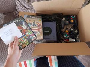 Nintendo GameCube console, 2 controllers, memory card, and three games