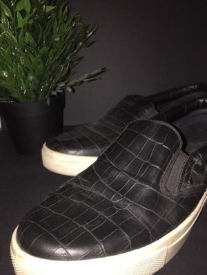 Crocodile skin slid on shoes