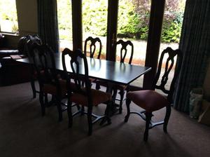 Dining room table and 6 chairs with matching display cabinet.