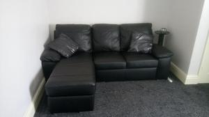 AS NEW Black leather corner chaise