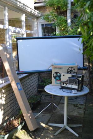 vintage projector for standard and super 8 cine and screen