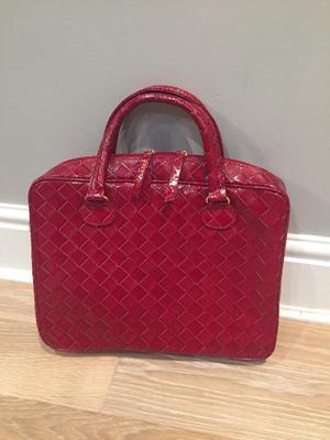 Woman's Estelle Lauder bag