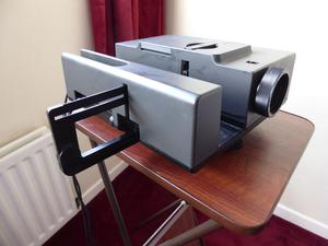 Vintage slide projector, stand and screen