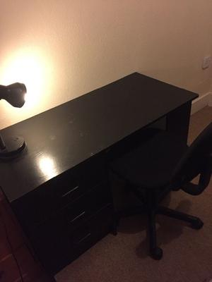 Black Office Chair and Desk Lamp