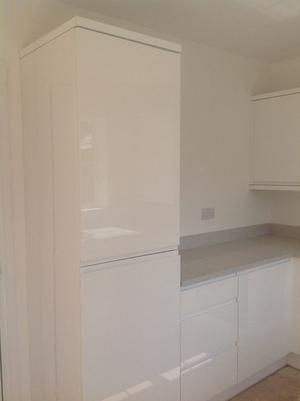 White kitchen units together with integrated appliances