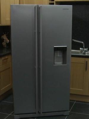 Silver samsung fridge freezer with water dispenser