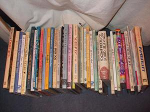 large collection of x-stitch books