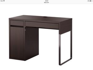 Black desk and black office chair