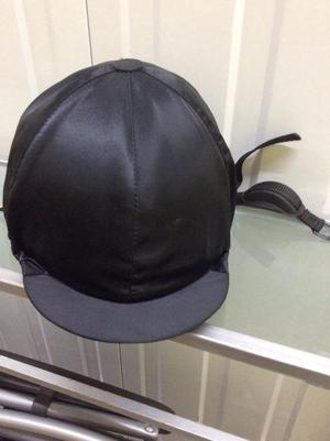 Black kite marked riding hat with detachable cover and chin strap, excellent condition.
