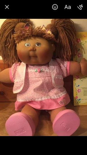Cabbage patch kid with certificates
