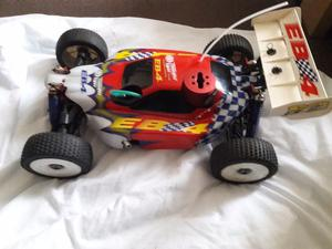 This is a thunder tiger EB4S2 PRO NITRO RC 18 SCALE BUGGY
