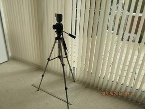 Canon A1 camera + Camera Kit Bag + Canon lens + tripod + accessories