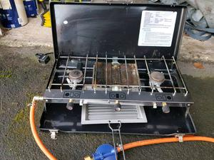 Camping cooker, gas bottle and accessories