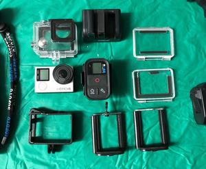 Go Pro Hero 4 w/ Go Pro Remote, 3 batteries and various accessories