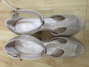 Nearly new Quiz gold shoes size 8