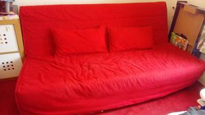 Ikea Three-seat sofa bed. Red cover. Used but in great condition.