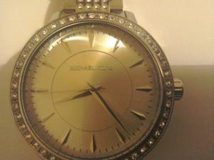 A man's or womans wrist watch maker Micheal kors good
