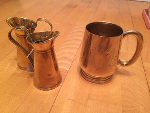 Brass mugs and jug