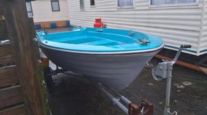 Fishing boat with trailer, double skinned and ready for water.