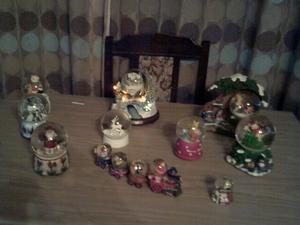a collection of snow globes including thomas kinkade jingle