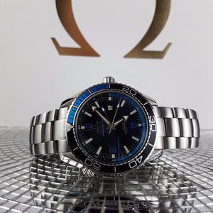 Silver Omega watch. Black and Blue Face and Bezel. Boxed with Paperwork. Free MK watch till Monday.