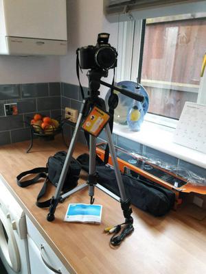 Virtually new camera with brand new tripod.