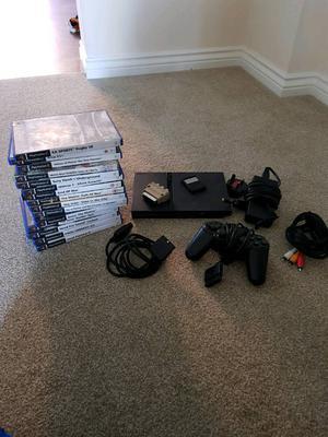 Sony playstation 2 + 15games