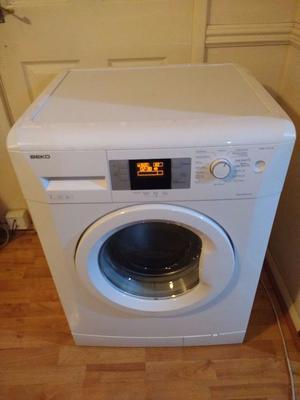 beko 7kg spin washing machine in black posot class. Black Bedroom Furniture Sets. Home Design Ideas