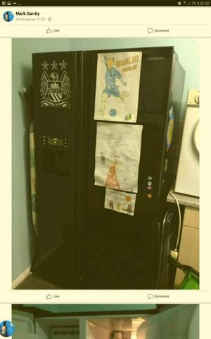 Black American fridge freezer with drink and ice dispenser. £250